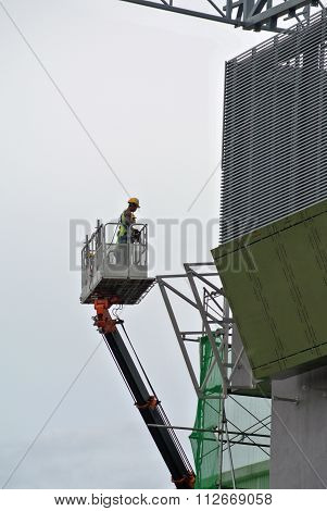 Construction workers using the mobile crane basket
