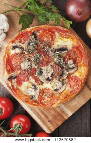 Puff pastry pizza with cheese, tomato and mushrooms