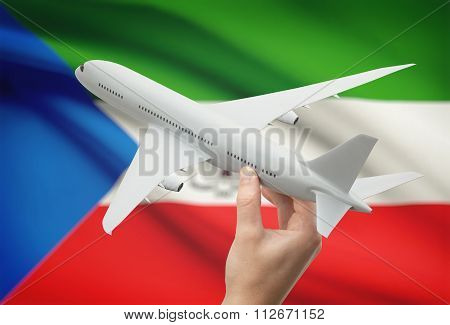 Airplane In Hand With Flag On Background - Equatorial Guinea