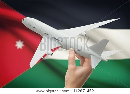 Airplane In Hand With Flag On Background - Jordan