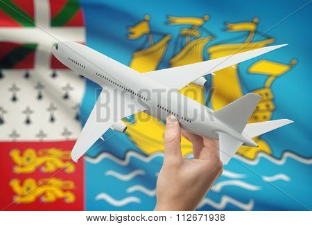 Airplane In Hand With Flag On Background - Saint Pierre And Miquelon