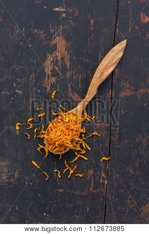 Dried petals Jerusalem artichoke in a wooden spoon