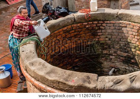 Woman At Water Well.