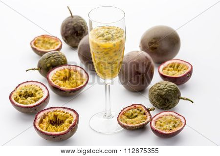 Passion Fruit Flesh In A Flute Amidst Cut Fruits