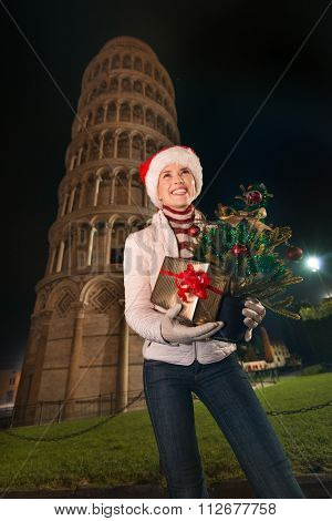 Woman With Christmas Tree And Gift Box Near Leaning Tower, Pisa