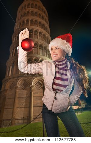 Woman In Santa Hat With Christmas Ball Near Leaning Tower, Pisa