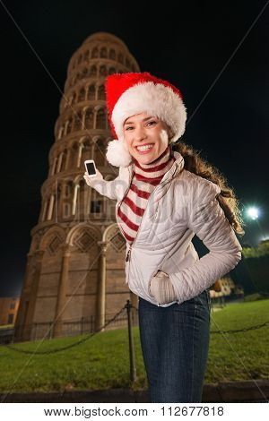 Woman In Santa Hat Taking Photo Of Leaning Tower Of Pisa, Italy
