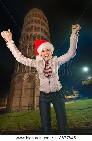 Happy Woman In Santa Hat Rejoicing Near Leaning Tower Of Pisa