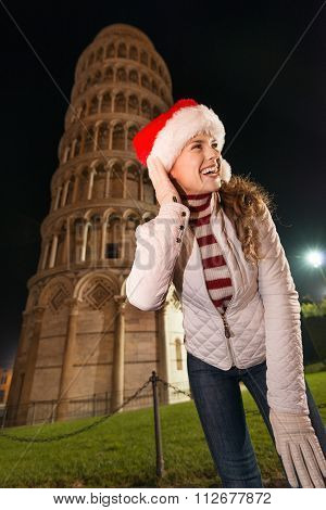 Smiling Woman In Santa Hat Standing Near Leaning Tower Of Pisa