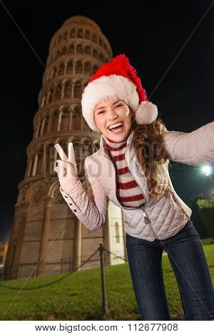 Woman In Santa Hat Taking Selfie And Showing Victory In Pisa