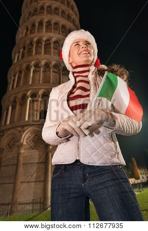 Woman In Santa Hat With Flag Looking Up Near Leaning Tower, Pisa