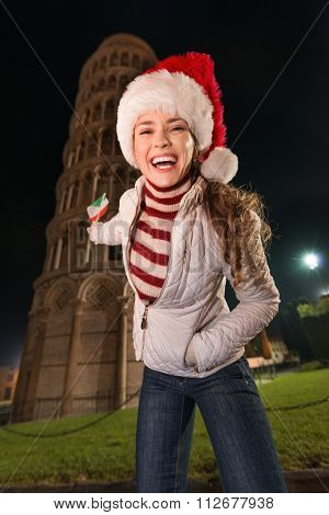 Woman In Santa Hat With Flag Pointing On Leaning Tower, Pisa