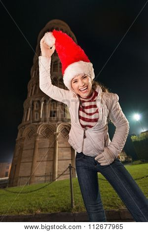 Woman Fooling Around With Santa Hat Near Leaning Tower Of Pisa