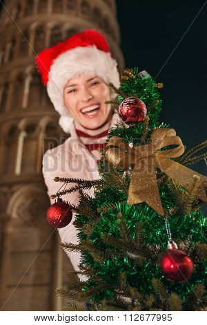 Closeup On Christmas Tree In Hands Of Woman. Pisa, Italy