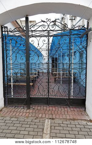 Wrought Iron Gates And Pillars Sidewalk Cafe