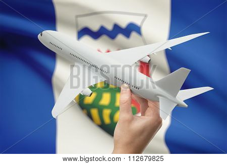 Airplane In Hand With Canadian Province Flag On Background - Northwest Territories