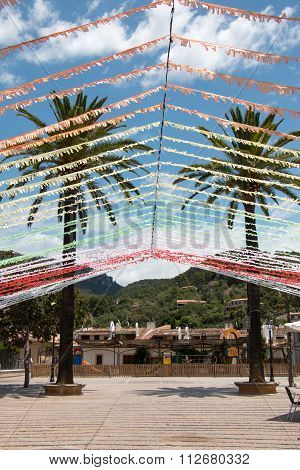 Two Big Palm Trees With Festive Paper Garlands At Plaza Mayor, Esporles, Majorca