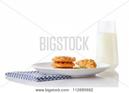 Stack of three homemade peanut butter cookies and halves of cookies on white ceramic plate on blue n