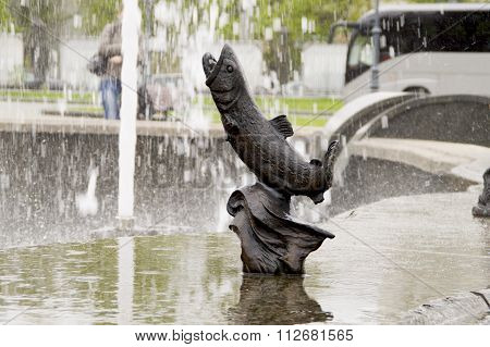 Sculpture of sea fish in the fountain parapet