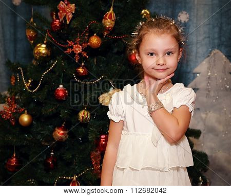 Beautiful Cute Little Kid Girl Posing In Fashion White Dress And Silver Bangle On Fir Tree Backgroun