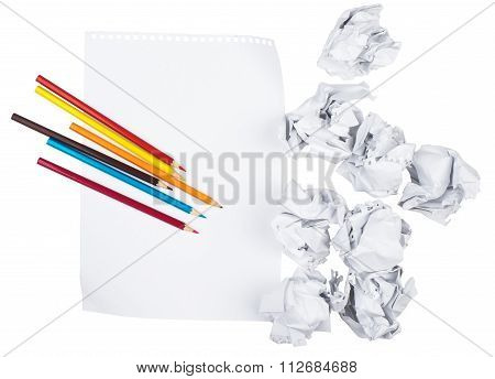 Paper with crayons and crumpled paper balls