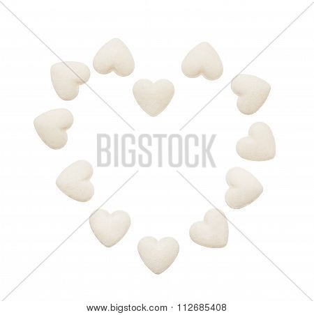 Heart made of white heart shape tablets