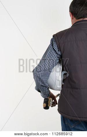 Adult Engineer Or Inspector Hand Holding White Plastic Helmet