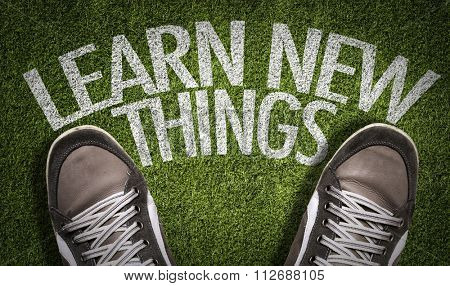 Top View of Sneakers on the grass with the text: Learn New Things