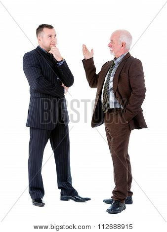Young And Old Senior Businessmans In Suits Argue And Swear.