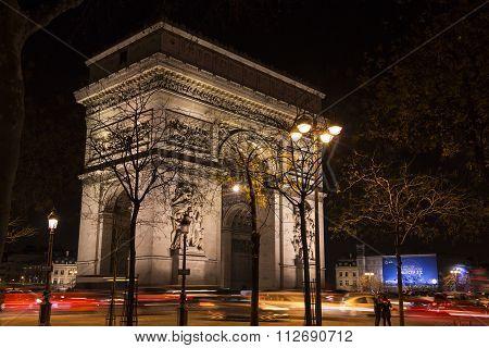 The Triumphal Arch At Night, Paris, France.