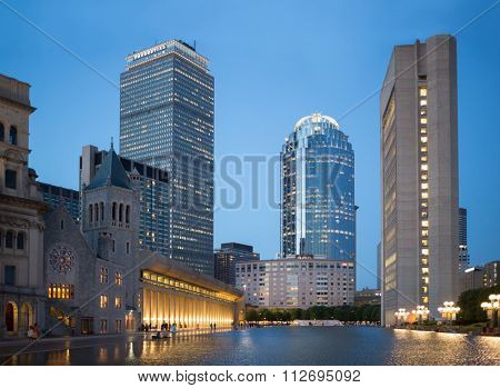 USA, BOSTON - SEP 06, 2014: Edifice of Christian Science Mother Church near pond in Christian Science Center at autumn evening.