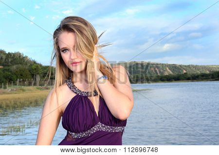 Attractive Blonde Lady Standing On A River Jetty