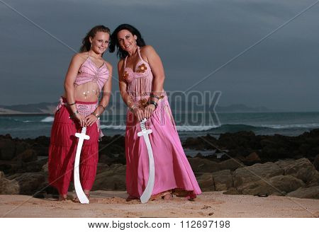 Mother And Daughter Crossing Swords On The Beach
