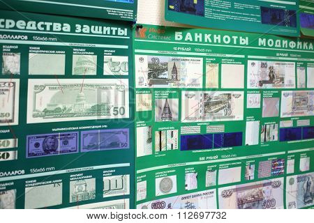 RUSSIA, MOSCOW - NOV 14, 2014: Stand with drawings of different money for identify a fake.