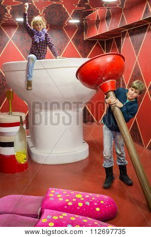 RUSSIA, MOSCOW - 04 NOV, 2014: Two children (with model releases) in large toilet at Giants house.
