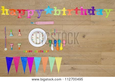 Directly above shot of birthday decorations on wooden table
