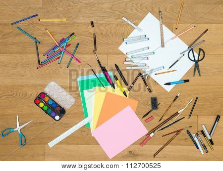 Directly above shot of art and craft tools on wooden table