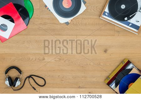Directly above shot of records with turntable on wooden table