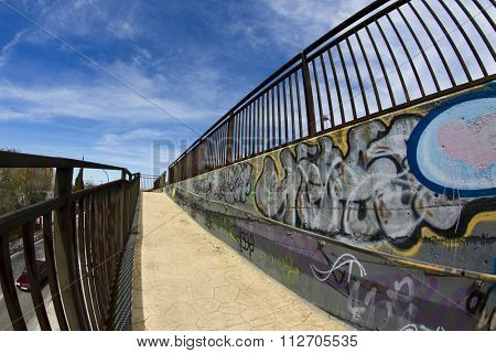 Colorful segment of a graffiti. Wall texture, urban architecture