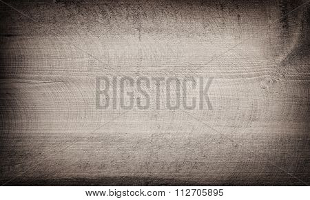 Grunge gray scratched wooden cutting board. Wood texture