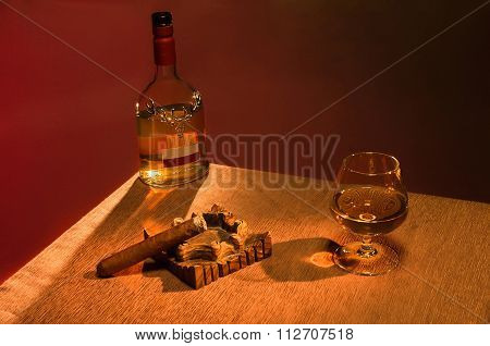 Whiskey with cigar over brown background