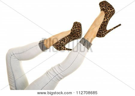Woman Legs In Denim Jeans And Cheetah Print Heels