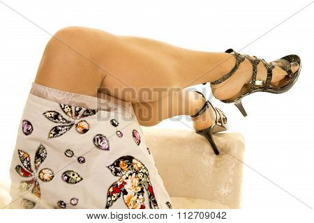 Woman Legs In Dress And Heels One Heel Down