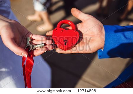 the wedding lock in hands of newlyweds.