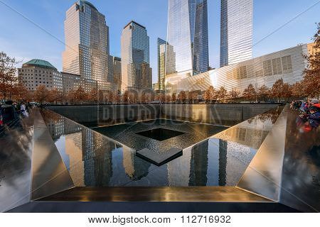 New York - Usa - December 20, 2015: People Near Freedom Tower And 9/11 Memorial