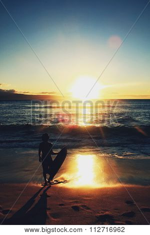Skim boarder and a Hawaiian sunset