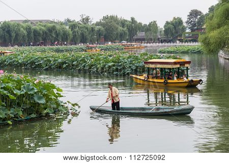 Beijing, China - Circa September 2015: People Sailing Boats In The Moat Around Forbidden Palace