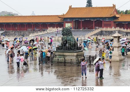 Beijing, China - Circa September 2015: Tourists In Forbidden Palace On The Rainy Day, Beijing,  Chin