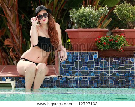 Sexy Brunette Lady Next To The Swimming Pool