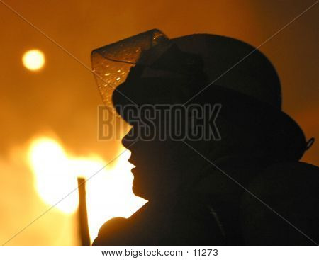Silhouette Of Firefighter poster
